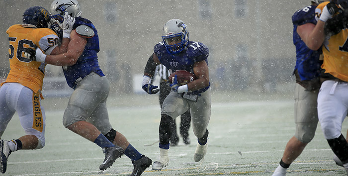 Justin Green dashes through hole and snow for second quarter TD for USF.